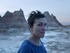 """This image released by Searchlight Pictures shows Frances McDormand in a scene from the film """"Nomadland."""" Chloe Zhao's film will premiere across the major fall film festivals in an alliance forged by the Venice, Toronto, New York and Telluride festivals. It's the first movie announced in the new partnership that has brought together the fall's biggest movie launch pads, which typically compete against each other for world premiere rights. (Searchlight Pictures via AP)"""
