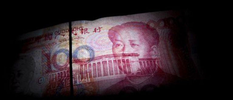 Nota de 100 yuans com o rosto de Mao Tsé-Tung.