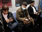 NEW YORK, NEW YORK - MARCH 11: A man wears a medical mask on the subway as New York City confronts the coronavirus outbreak on March 11, 2020 in New York City. President Donald Trump announced on Wednesday evening that he is restricting passenger travel from 26 European nations to the U.S. in an effort to contain the coronavirus which is rapidly spreading throughout the world and America.   Spencer Platt/Getty Images/AFP == FOR NEWSPAPERS, INTERNET, TELCOS & TELEVISION USE ONLY ==