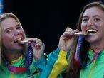 Tokyo 2020 Olympics - Tennis - Women's Doubles - Medal Ceremony - Ariake Tennis Park - Tokyo, Japan - August 1, 2021. Bronze medallists Laura Pigossi of Brazil and Luisa Stefani of Brazil celebrate on the podium REUTERS/Edgar Su