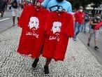 A vendor holds t-shirts depicting former president Luiz Inacio Lula Da Silva during a demonstration against Brazil's President Jair Bolsonaro's handling of the coronavirus disease (COVID-19) pandemic and to impeach him, in Rio de Janeiro, Brazil, June 19, 2021. REUTERS/Pilar Olivares