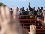 Brazil's President Jair Bolsonaro looks on as people pray after he participated in a motorcade rally amid the coronavirus disease (COVID-19) pandemic, in Sao Paulo, Brazil, June 12, 2021. REUTERS/Amanda Perobelli