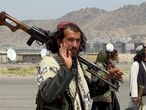 Taliban forces patrol at a runway a day after U.S troops withdrawal from Hamid Karzai International Airport in Kabul, Afghanistan August 31, 2021. REUTERS/Stringer     TPX IMAGES OF THE DAY