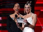 FILE PHOTO: Alicia Keys and Dua Lipa react as they read the name of Billie Eilish to win the best Best New Artist award at the 62nd Grammy Awards show in Los Angeles, California, U.S., January 26, 2020. . REUTERS/Mario Anzuoni/File Photo
