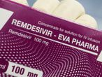 "FILE PHOTO: A lab technicians shows the coronavirus disease (COVID-19) treatment drug ""Remdesivir"" at Eva Pharma Facility in Cairo, Egypt June 25, 2020. REUTERS/Amr Abdallah Dalsh/File Photo"