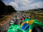 Supporters of the Brazilian President Jair Bolsonaro take part in a motorcade to protest against the President of the Chamber of Deputies Rodrigo Maia, Brazilian Supreme Court, quarantine and social distancing measures, amid the coronavirus disease (COVID-19) outbreak, in Brasilia, Brazil May 17, 2020. REUTERS/Adriano Machado