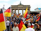 Berlin (Germany), 27/05/2018.- People hold German flags during a rally of the 'Alternative for Germany' (AfD) party at the Brandenburg Gate in Berlin, Germany, 27 May 2018. The AfD has called for a large demonstration under the motto 'Future Germany' (Zukunft Deutschland) to which they expect more than 5,000 participants. Various alliances of parties, cultural workers and civil society have organized counter-demonstrations and rallies, which are also expected to attract more than 10,000 participants. (Alemania) EFE/EPA/OMER MESSINGER
