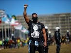 A demonstrator wearing a t-shirt with the image of Malcolm X raises a fist during a protest against Brazil's President Jair Bolsonaro and racism, in Brasilia, Brazil, June 21, 2020. REUTERS/Adriano Machado