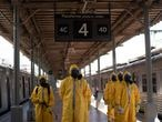 Soldiers stand in formation before disinfecting wagons for the new coronavirus at the central train station in Rio de Janeiro, Brazil, where trains connect cities within the state, March 26, 2020. (AP Photo/Leo Correa)