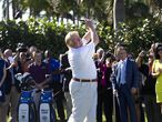 Donald Trump shows off his updated golf course by hitting a ceremonial tee shot off the 1st tee at Trump National Doral, February 6, 2014, in Doral, Fla. (David Walters/Miami Herald/Tribune News Service via Getty Images)