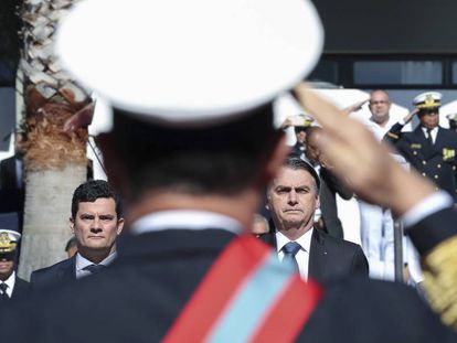 Jair Bolsonaro, ao lado de Sergio Moro, num ato realizado em 11 de junho em Brasília.