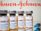"FILE PHOTO: Vials with a sticker reading, ""COVID-19 / Coronavirus vaccine / Injection only"" and a medical syringe are seen in front of a displayed Johnson & Johnson logo in this illustration taken October 31, 2020. REUTERS/Dado Ruvic/Illustration/File Photo"
