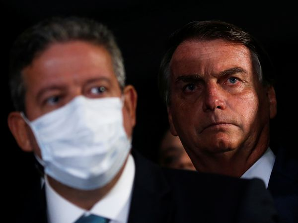 President of Brazil's Lower House Arthur Lira speaks next  Brazil's President Jair Bolsonaro during a news conference at the National Congress in Brasilia, Brazil February 23, 2021. REUTERS/Adriano Machado