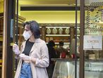 Rome (Italy), 04/05/2020.- A customer with his take away coffee leaves the historic 'Golden Cup' bar in Rome, Italy, 04 May 2020, during the coronavirus disease (COVID-19) pandemic. Italy entered the second phase of its coronavirus emergency on 04 May with the start of the gradual relaxation of the lockdown measures that have been in force for 55 days. (Italia, Roma) EFE/EPA/MAURIZIO BRAMBATTI BT