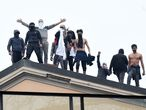 MILAN, ITALY - MARCH 09:  Prisoners of the San Vittore Prison protest on the roof against their treatment during the coronavirus outbreak in Milan, Italy on March 09, 2020 in Milan, Italy. (Photo by Pier Marco Tacca/Anadolu Agency via Getty Images)