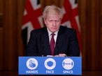 """Britain's Prime Minister Boris Johnson attends a virtual press conference inside 10 Downing Street in central London on December 19, 2020. - British Prime Minister Boris Johnson on Saturday announced a """"stay at home"""" order for London and southeast England to slow a new coronavirus strain that is significantly more infectious. The new strain of the virus """"does appear to be passed on significantly more easily,"""" Johnson said at a televised briefing. He ordered new restrictions for London and south-eastern England from Sunday, saying that under the new """"tier four"""" rules, """"residents in those areas must stay at home"""" at least until December 30. (Photo by TOBY MELVILLE / POOL / AFP)"""