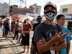 People wait in line in front of a public bank to try to receive emergency aid given by the federal government to the most vulnerable, amid the coronavirus disease (COVID-19) outbreak, in Jacarei, Sao Paulo state, Brazil, April 15, 2020. REUTERS/Roosevelt Cassio