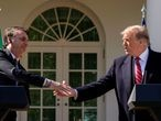 FILE PHOTO: Brazil's President Jair Bolsonaro shakes hands with U.S. President Donald Trump during a joint news conference in the Rose Garden of the White House in Washington, U.S., March 19, 2019. REUTERS/Kevin Lamarque/File Photo