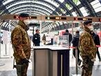 Italian army soldiers patrol the gates of Milan main train station, Italy, Monday, March 9, 2020. Italy took a page from China's playbook Sunday, attempting to lock down 16 million people — more than a quarter of its population — for nearly a month to halt the relentless march of the new coronavirus across Europe. Italian Premier Giuseppe Conte signed a quarantine decree early Sunday for the country's prosperous north. Areas under lockdown include Milan, Italy's financial hub and the main city in Lombardy, and Venice, the main city in the neighboring Veneto region. The extraordinary measures will be in place until April 3. (Claudio Furlan/LaPresse via AP)