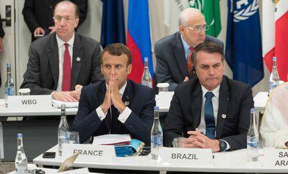O presidente francês, Emmanuel Macron, junto a seu homólogo brasileiro, Jair Bolsonaro, no G20 de Osaka, nesta sexta-feira.