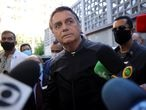Brazil's President Jair Bolsonaro speaks to the media as he leaves Vila Nova Star Hospital, where he was treated due to obstructed intestine, in Sao Paulo, Brazil July 18, 2021. REUTERS/Amanda Perobelli