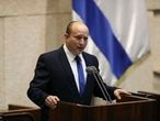 Israel's designated new prime minister, Naftali Bennett speaks during a Knesset session in Jerusalem Sunday, June 13, 2021. Bennett is expected later Sunday to be sworn in as the country's new prime minister, ending Prime Minister Benjamin Netanyahu's 12-year rule. (AP Photo/Ariel Schalit)