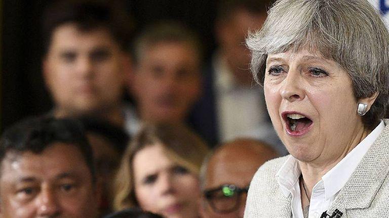 Theresa May durante comício eleitoral.