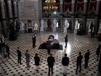 Capitol Hill staffers pay their respects to late Associate Justice Ruth Bader Ginsburg in the Statuary Hall, where she lies in state at the US Capitol, September 25, 2020 in Washington, DC. (Photo by Greg Nash / POOL / AFP)