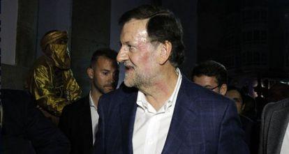 Rajoy, com rosto vermelho após receber o golpe.
