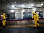 Workers spray disinfectant in the Ceilandia metro station, amid coronavirus disease (COVID-19) outbreak, in Brasilia, Brazil April 7, 2020. REUTERS/Ueslei Marcelino