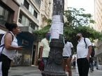 People look at job listings posted on a light pole in downtown Sao Paulo, Brazil, October 6, 2020. Picture taken October 6, 2020. REUTERS/Amanda Perobelli