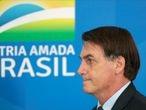 Brazil's President Jair Bolsonaro arrives at a media statement announcing economic measures, amid coronavirus disease (COVID-19) outbreak, in Brasilia, Brazil, April 1, 2020. REUTERS/Ueslei Marcelino