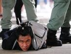 A man lies on the ground as he is detained by riot police during a march against the national security law at the anniversary of Hong Kong's handover to China from Britain in Hong Kong, China July 1, 2020. REUTERS/Tyrone Siu