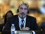 FILE - In this Tuesday, Aug. 16, 2016 file photo, founder of the first commercial anti-virus program that bore his name, John McAfee listens during the 4th China Internet Security Conference (ISC) in Beijing. Spain's National Court has approved the extradition of detained antivirus software entrepreneur John McAfee to the United States, where he is wanted on tax-related criminal charges that carry a prison sentence of up to 30 years. (AP Photo/Ng Han Guan, File)