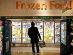 A customer looks at products in the frozen food section at JD's 7Fresh supermarket on China's Singles Day shopping festival during a government organized tour in Beijing, China November 11, 2020. REUTERS/Thomas Peter