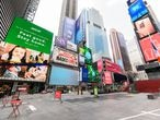 NEW YORK, NEW YORK - AUGUST 27: Times Square sits empty as the city continues Phase 4 of re-opening following restrictions imposed to slow the spread of coronavirus on August 27, 2020 in New York City. The fourth phase allows outdoor arts and entertainment, sporting events without fans and media production. (Photo by Noam Galai/Getty Images)