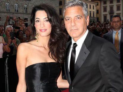 Amal Alamuddin e George Clooney, domingo em Florença.