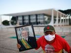 A supporter of Brazil's former President Luiz Inacio Lula da Silva holds a portrait of Lula during a protest in front of the Supreme Court in Brasilia, Brazil, April 15, 2021. REUTERS/Adriano Machado