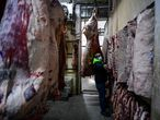 A butcher works at a butcher's shop in Liniers neighborhood, Buenos Aires, on 18 May 2021. - Argentine meat producers announced on Tuesday they would stop selling beef and veal for one week in response to a month-long government suspension on exports due to rising prices on the domestic market. (Photo by RONALDO SCHEMIDT / AFP)