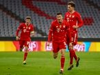 Bayern's Robert Lewandowski celebrates after scoring from a penalty kick during the Champions League, round of 16, second leg soccer match between FC Bayern Munich and Lazio at the soccer Arena stadium in Munich, Germany, Wednesday, March 17, 2021. (AP Photo/Matthias Schrader)
