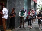 People wait in line to enter a bank during the outbreak of the coronavirus disease (COVID-19), in the Copacabana neighbourhood in Rio de Janeiro, Brazil April 9, 2020. REUTERS/Pilar Olivares