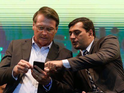O presidente Bolsonaro e o governador do Amazonas, Wilson Lima, em 27 de novembro de 2019, em Manaus.