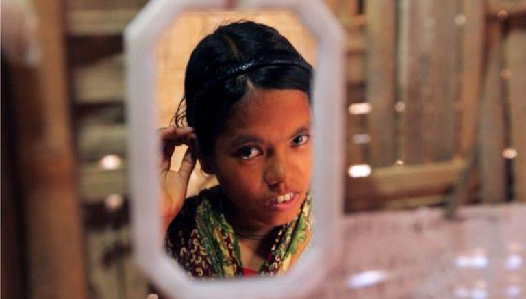 Nilima, uma menina de Bangladesh de 14 anos.