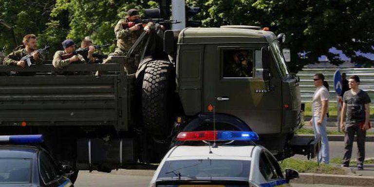 Um caminhão com milicianos a caminho do aeroporto de Donetsk.