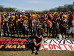 Brazilian indigenous Kayapo people take part in a protest by opposition parties and social movements against Brazilian President Jair Bolsonaro's handling of the COVID-19 pandemic in Brasilia, on June 19, 2021. - Far-right President Jair Bolsonaro has been facing criticism for his management of the pandemic, including initially refusing offers of vaccines, as epidemiologists warn Brazil may now be on the brink of a third wave of Covid-19. (Photo by Sergio Lima / AFP)