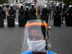 A resident of Paraisopolis, one of the city's largest slums, takes part in a protest in Sao Paulo, Brazil, on May 18, 2020, to demand more aid from Sao Paulo's state government during the COVID-19 coronavirus pandemic. (Photo by Miguel SCHINCARIOL / AFP)