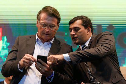 O presidente Jair Bolsonaro e o governador do Amazonas, Wilson Lima, em solenidade no dia 27 de novembro de 2019, em Manaus.