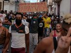 People shout slogans against the government during a protest against and in support of the government, amidst the coronavirus disease (COVID-19) outbreak, in Havana, Cuba July 11, 2021. REUTERS/Alexandre Meneghini