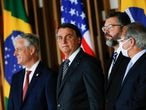 U.S. National Security Advisor Robert O'Brien, Brazil's President Jair Bolsonaro, Brazil's Foreign Minister Ernesto Araujo and Brazil's Economy Minister Paulo Guedes look on before a statement to the media at the Itamaraty Palace in Brasilia, Brazil, October 20, 2020. REUTERS/Adriano Machado