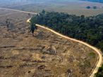 (FILES) This file picture taken on August 24, 2019 shows an aerial view of burnt areas of the Amazon rainforest, near Porto Velho, Rondonia State, Brazil. - Deforestation in the Brazilian Amazon reached 1,358 km2 in August 2020, a decrease of 21% compared to the same month of 2019, but the deforested area is already much higher than that of the whole of 2018. (Photo by Carlos FABAL / AFP)